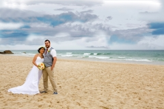 wedding couple standing on burleigh beach
