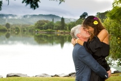 couple kissing outside in the serene setting wedding photo