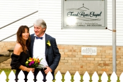 close up of the couple outside Tweed River Chapel
