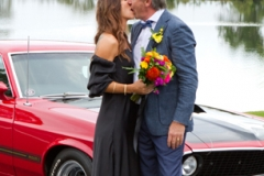 bride and groom kissing on their wedding day on Tweed River, Tumbulgum