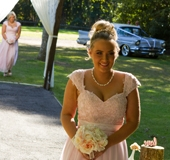 first brides maid walks down the aisle
