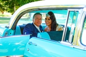 Bride and Groom in brilliant blue old Holden car