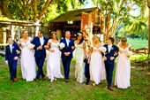 whole bridal party walking arm in arm at Boomerang farm