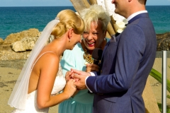 bride and groom and celebrant, celebrant and bride having a giggle together