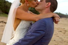 Groom picking up bride for a kiss
