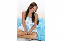 Ange pretty in studio in blue floral dress with blue cushions