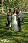 The bride walked down the aisle by both her mum and dad