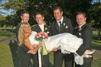 Danielle being picked up by the groomsmen