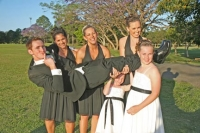 Chris being picked up by the brides maids