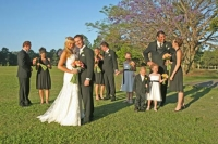 The whole wedding party on the green of golf course