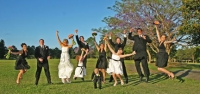 The wedding party jumping like the Toyota add