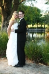 full length photo of Danielle and chris in front of the lake