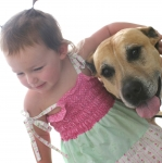Abbey and Bruce-3 year old girl with Bruce her dog under arm