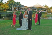 The bridal party with the venue in the back ground
