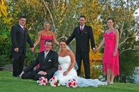 The bridal party with bride and groom sitting