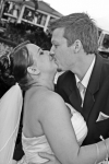Nikki and Daniel kissing in black and white