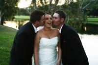 Groomsmen kissing Nikki on cheek