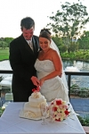 Nikki and Daniel cutting the wedding cake