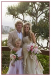 bride, groom and their daughter at Coolangatta