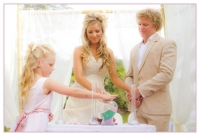 bride and groom during ceremony with their daughter