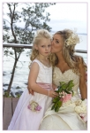 bride kissing her daughter