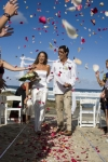Sharna and Randall walking down the isle with rose petals falling all over them AFFORDABLE WEDDING PHOTOGRAPHY GOLD COAST