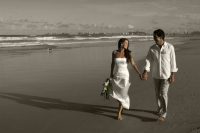 A sepia toned photo, of the couple walking along Currumbin Beach, AFFORDABLE WEDDING PHOTOGRAPHY GOLD COAST