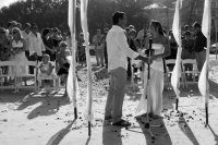 A black and white photo of Sharna and Randall taking their wedding vows