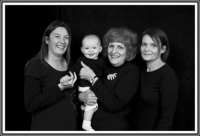 3 generations of girls in studio-black back drop-black and white photo