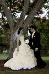 Tahlia and Andrew under a tree The Glades Golf Course