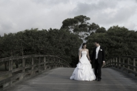 Tahlia and Andrew on the bridge in the grounds of The Glades
