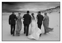 The bridal party walking away in black and white