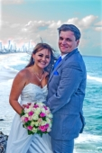 AFFORDABLE WEDDING PHOTOGRAPHY GOLD COAST-couple perched on the edge of cliff-North Burleigh Headland