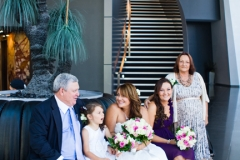 Bride and family waiting for limo