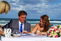 signing the paper work-AFFORDABLE WEDDING PHOTOGRAPHY GOLD COAST