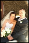 bride and groom in cane lounge chair