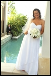 bride standing by the river pool