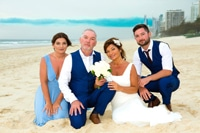 photo of bride and groom with their two children at their elopement