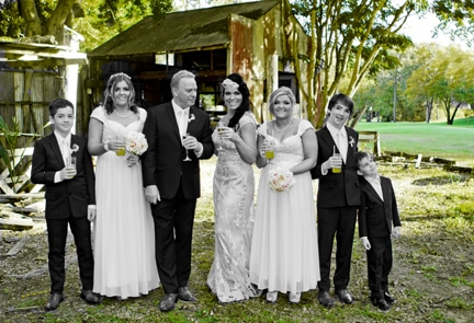 Bride and Groom with all their children at Boomerang Farm, Black and white photo with splashes of colour