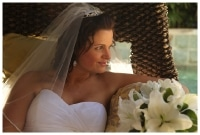Bride on cane chair by the pool