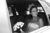 Bride looking out limousine window