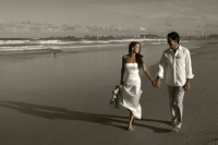 AFFORDABLE WEDDING PHOTOGRAPHY GOLD COAST-black and white photo, couple in colour walking along Currumbin Beach