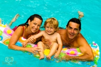 Gold Coast. Family of 3 portrait in the pool