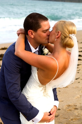 Bride and Groom kissing on beach