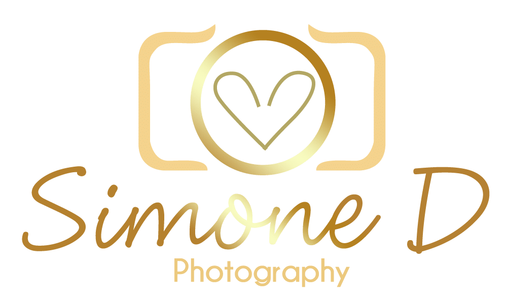 Gold Coast Wedding Photography-Simone D Photography logo in gold looks like a camera with heart in centre of lens