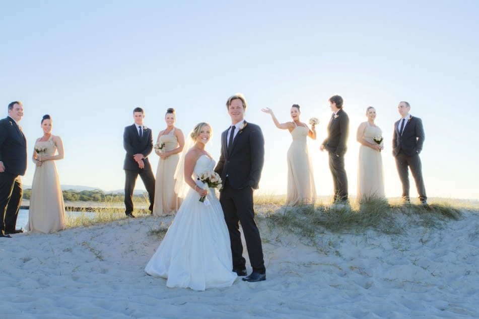 Bridal party of ten people on a sand dune at Currumbin