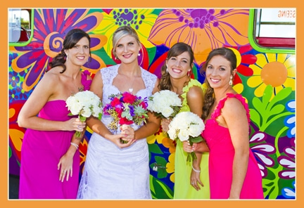 Bride and three brides maids in front of colourful hippy double decker bus
