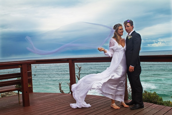 young wedding couple on North Burleigh Head land, veil blowing